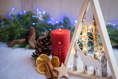 Christmas ornaments with snow, pine tree, cone and candles Stock Photo