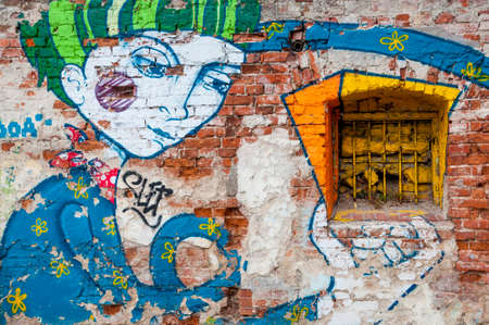window graffiti: Colorful small window and graffiti on the brick wall Stock Photo
