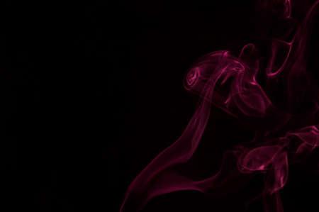 black swirls: Swirls of red smoke on a black background