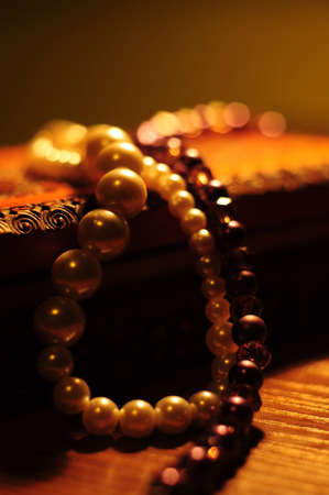 jewellery box: Pearl necklaces on wooden jewellery box Stock Photo