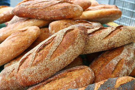 menton: Loafs of handmade sesame bread on market in Menton, town in South France, French riviera