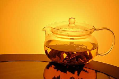 Glass teapot on glass table