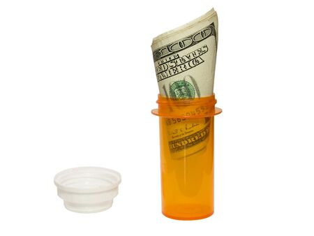 expensive: Prescrption bottle and cash, showing how expensive medicine is. Stock Photo