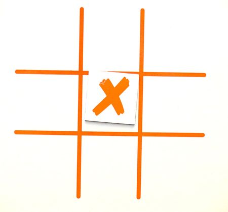 x marks the spot: X marks the spot, even though this is a tic tac toe game. Theres a concept in there somewhere. Stock Photo