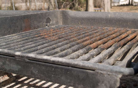 Old rusty grill, but certainly still useable. Stock Photo