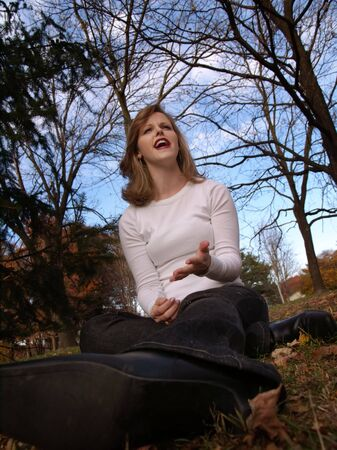 Woman sitting in park, complaining about something. Stock fotó