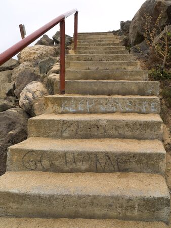 Worn concrete stairs, complete with graffiti.