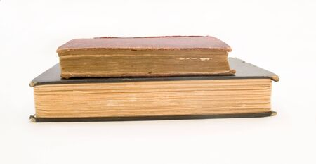 Stack of old books, isolated on white.