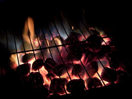 Long exposures of coals buring underneath a grill. Stock Photo - 4461860