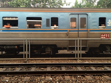 fence: Blue train cars at Station
