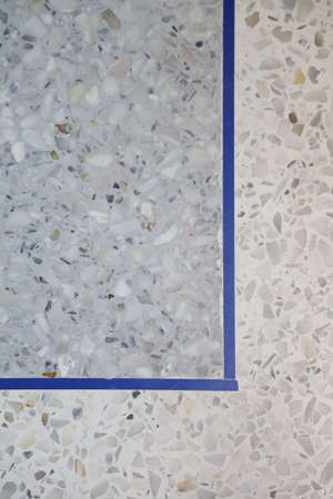 Gray terrazzo floor with separate line. Interior texture background and construction concept. Vertical.