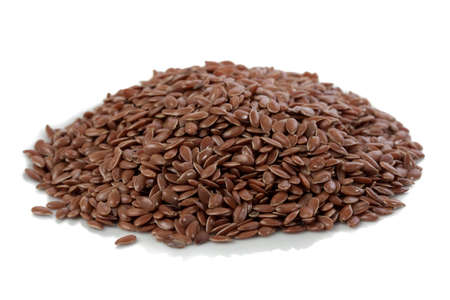 constituent: Pile of flax seeds isolated on white background Stock Photo