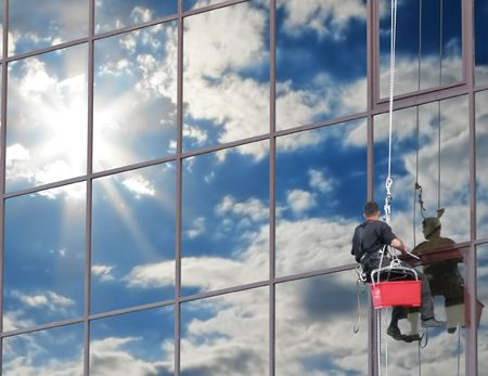 cleaning an office: If you wash the windows regularly, they will reflect the blue sky Stock Photo
