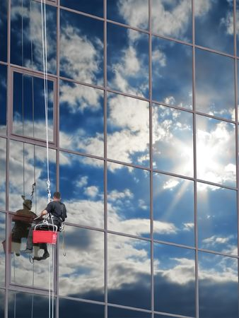 regularly: If you wash the windows regularly, they will reflect the blue sky Stock Photo