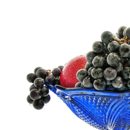 Bunches of grapes, red apple, vase, drops photo