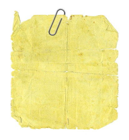 Old yellow paper and the paper clip Stock Photo