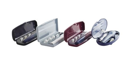 selfcontrol: Four insulin pens with a containers and disposable needles Stock Photo