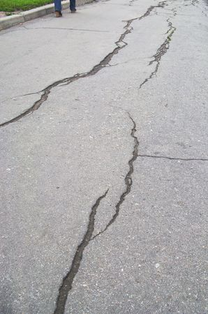 Large cracks along the asphalted footway