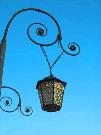 Pendant street lantern with a gold ornament