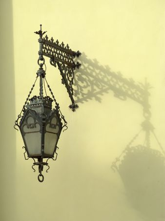 Vintage wall-mounted lantern with shadow, Saint Petersburg, Russia