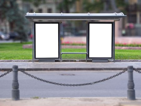 City bus stop with two publicity boards Stock Photo
