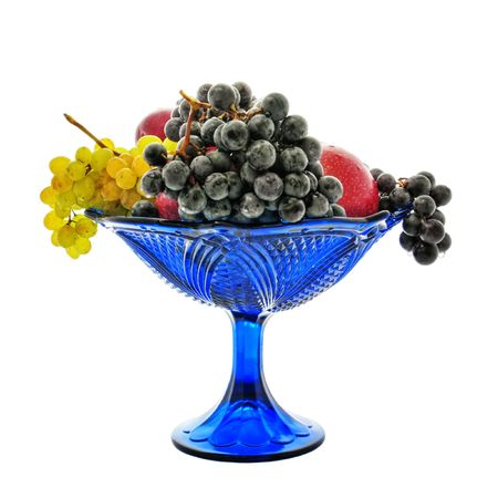 Bunches of grapes, red apples, plum, vase, drops Stock Photo