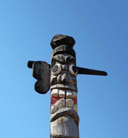 Wooden idol on the background of blue sky. A Jangseung (village guardian) is a Korean totem pole, to scare away demons. Stock Photo - 6051561