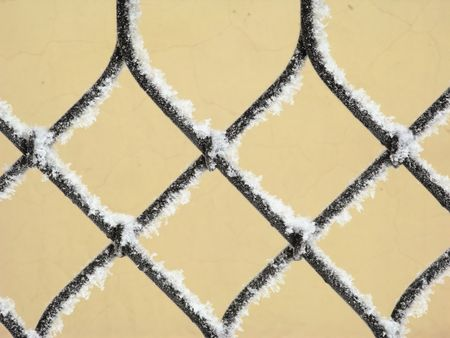Part of decorative lattice covered with snow, close-up