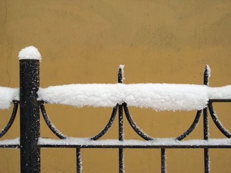Part of decorative lattice covered with snow Stock Photo