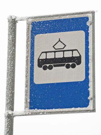 Sign tram station covered with snow and ice