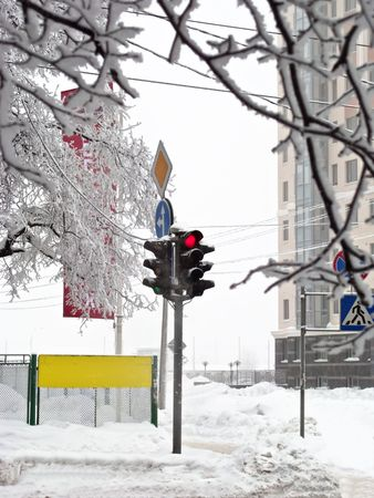 Winter crossroads with traffic lights, snow drifts, road signs Stock Photo - 6272297
