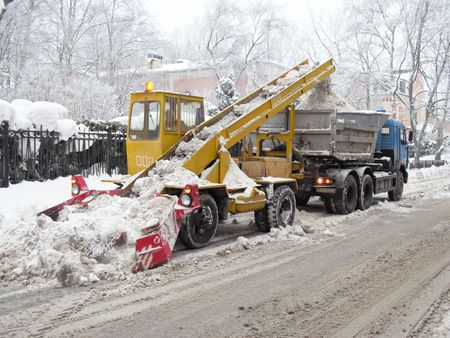 Snow-removal machine cleans the street of snow