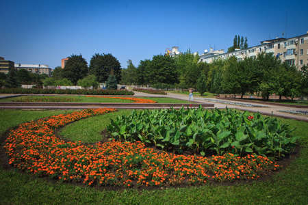Lawns and shaped flower beds on Pushkin Boulevard, Donetsk municipal park zone Stock Photo