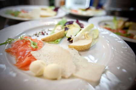 salmon dish with fruit and salad Stock Photo