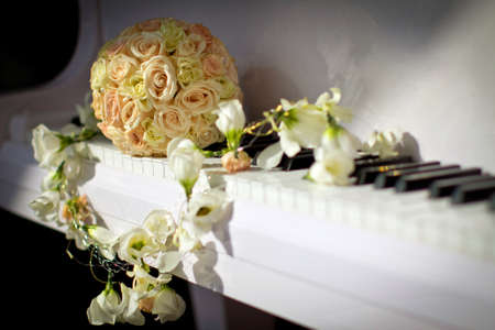 brides bouquet on the piano, wedding decoration