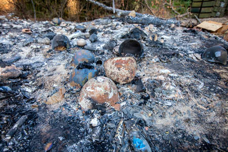 burned-out military ammunition, helmets, War actions aftermath, Ukraine and Donbass conflict