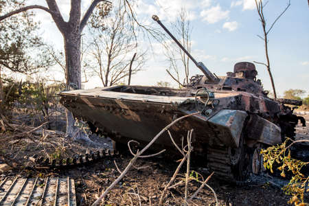 destroyed infantry combat vehicle, War actions aftermath, Ukraine and Donbass conflict, burnt military equipment Stock Photo