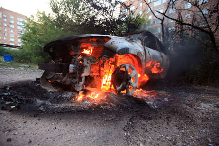burning civilian car in the city, the consequences of fire, War actions aftermath, Ukraine and Donbass conflict 版權商用圖片
