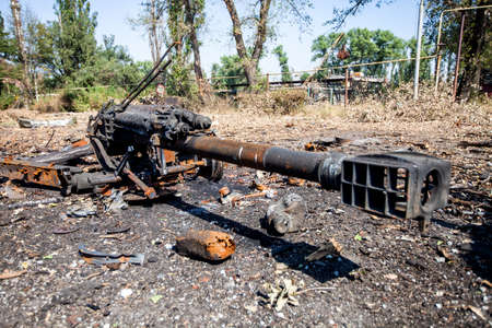 gun barrel, burned artillery gun, War actions aftermath, Ukraine and Donbass conflict
