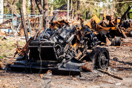 War actions aftermath, Ukraine and Donbass conflict, burnt-out vehicles, twisted metal