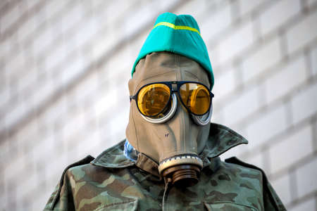 War actions aftermath, Ukraine and Donbass conflict, dummy for deception of snipers of the opponent in a gas mask and points 版權商用圖片