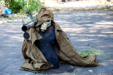 War actions aftermath, Ukraine and Donbass conflict, dummy for deception of snipers of the opponent in military clothes and with the grenade launcher on a shoulder