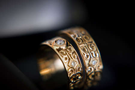carved wedding rings with jewels, closeup