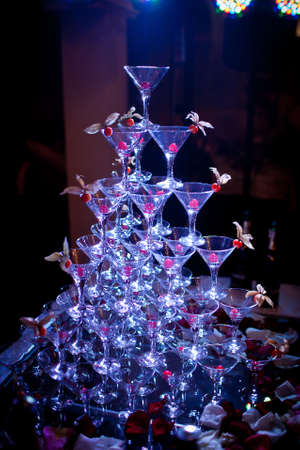 pyramid of glasses, cherry in the glass, winter cherry, blue light Banco de Imagens