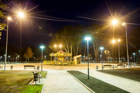public Park infrastructure, night lighting, children's attraction Stock Photo