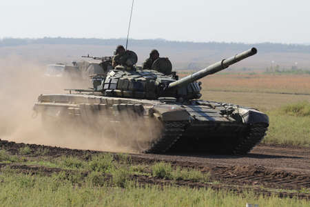 The tank goes in the field, the conflict between Ukraine and Donbass, Military training at the site near Donetsk, September 2016 Editorial
