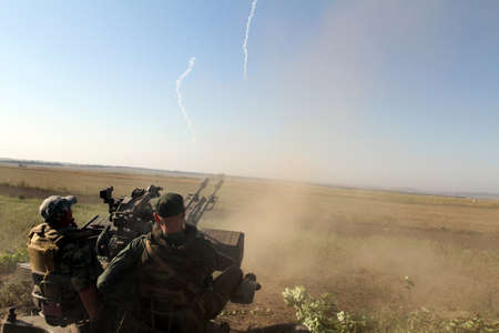 Anti-aircraft gun in action, military action, the conflict between Ukraine and Donbass, Military training at the site near Donetsk, September 2016