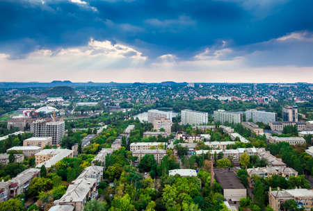 Panorama of the city of Donetsk from a great height, slagheaps on the horizon