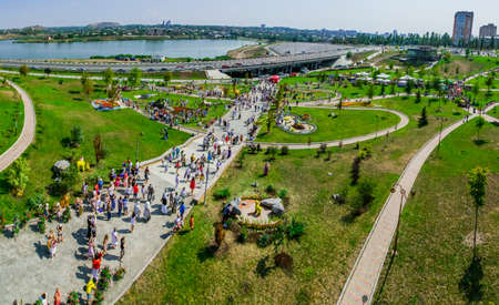 Panorama of the City day celebration fair and installations in the park in the city of Donetsk, Ukraine, August 25, 2013