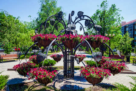 Forged metal architectural form with petunias pots, elements of park infrastructure, Donetsk, may 2013 Editorial